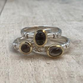 Trois anneaux aux Onyx noirs chez CANYON